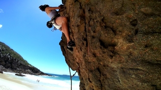 Millie Climbing the bolted 18 at Paradise Beach